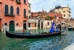 Gondola with a new Sophia Loren on the Mendicanti Canal, in front of the Cavallo Bridge, along San Giovanni e Paolo's Square in the Castello District in Venice