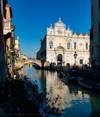 The Scuola Grande San Marco, the Cavallo Bridge and the Mendicanti Canal along the San Giovanni e Paolo's Square in the Castello District in Venice