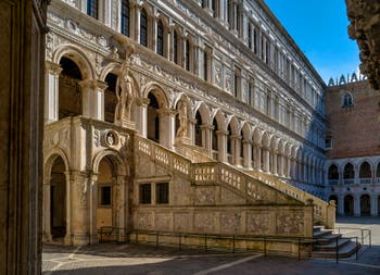 The Doge's Palace Giants' Staircase in Venice with Mars and Neptune.