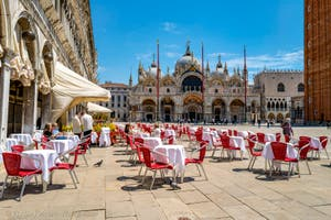 The Quadri Cafe on Saint-Mark Square and the Basilica in Venice.