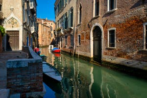 The entrance of the Van Axel Palace and the Panada Canal reflections in the Cannaregio District in Venice.
