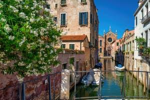 The Brazzo Canal and the Madona de l'Orto Church in the Cannaregio District in Venice.