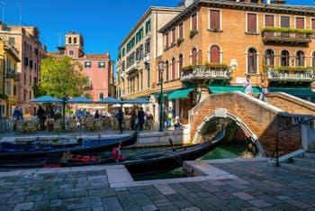 Gondolas on the Miracoli Canal, in front of the Santa Maria Nova Square and Bridge in the Cannaregio District in Venice.