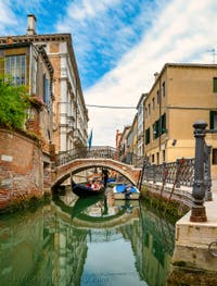 Gondola on the San Severo Canal and under its Bridge, in the Castello District in Venice.