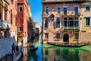 Gondolas in front of the Anzolo Bank and the Soranzo Palace, in the Castello District in Venice.