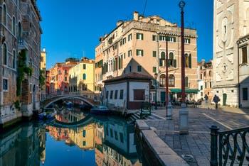 The Mondo Novo Canal mirror and Santa Maria Formosa bank, in the Castello District in Venice.