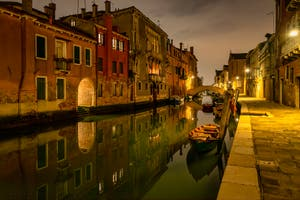 Venice by Night: The Gasparo Contarini Bank and the Madonna de l'Orto Canal and Bridge in the Cannaregio District in Venice.
