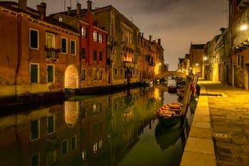 Venice by Night: The Gasparo Contarini Bank and the Madonna de l'Orto Canal and Bridge in the Cannaregio District in Venice.