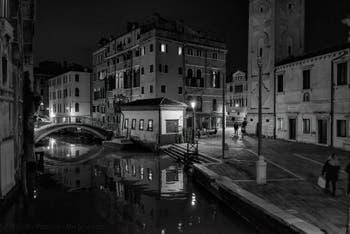 The Mondo Novo Canal reflections and the Santa Maria Formosa Bank in the Castello District in Venice.