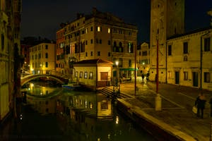 The Mondo Novo Canal reflections and the Santa Maria Formosa Bank in the Castello District in Venice.
