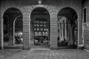 The Erbaria Square and the Fontego dei Tedeschi in the background in Venice.