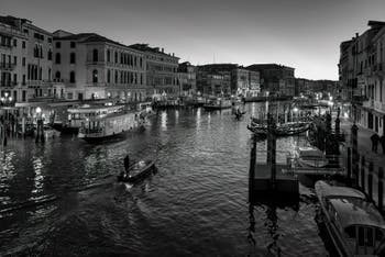 Water Buses and Gondolas on Venice Grand Canal seen from the Rialto Bridge.