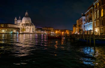 The Madonna de la Salute Church and Venice Grand Canal by night.