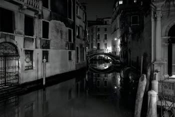 The San Zulian Canal reflections and the Balbi Bridge in Venice.