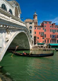 The Rialto Bridge beauty and the gondola elegance in Venice.