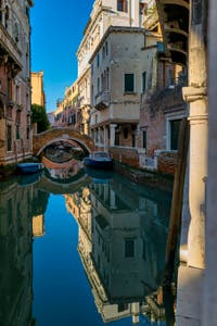 Venice Mirors: The Ca' Widmann Canal and Bridge in the Cannaregio District in Venice.