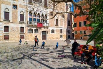 Venetian life on Bandiera e Moro Bragora Square in the Castello District in Venice.