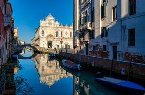 Beauty and Blue Sky: The Scuola Grande San Marco's reflections in the Castello District in Venice.