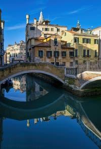 The Mirrors of Venice: The Mondo Novo Canal and the Querini Stampalia Square in the Castello in Venice.