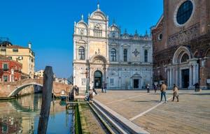 The Scuola Grande San Marco and the Santi Giovanni e Paolo Square in the Castello District in Venice.