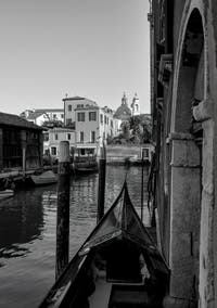 Gondola on the Ognissanti Canal, in the background, the Nani Bank, in the Dorsoduro District in Venice.