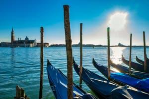 Saint Mark's Basin Gondolas and the San Giorgio Maggiore Island in Venice.