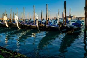 Sun on the St. Mark's Basin Gondolas' Fèrro (iron) in Venice.