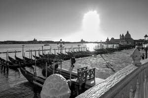 St. Mark's Basin Gondolas and Pier in Venice, in the background, the Salute Church.