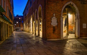 The Becarie Street and the Rialto Fish Market by night in the San Polo District in Venice.
