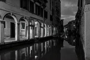 The mirror of the Santi Apostoli Canal and the Sotoportegho del Tragheto in the Cannaregio District in Venice.