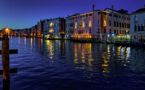 Venice Grand Canal by night with the Ca' d'Oro and Ca' Sagredo Palaces.