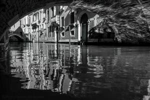 The Palazzo Canonica Canal's reflections in the San Marco District in Venice.