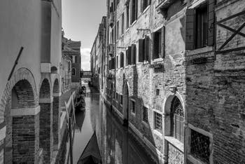Del Vin Canal and Bank with its gondolas in Saint-Mark District in Venice.