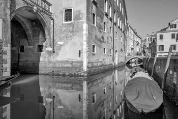 Sant'Anzolo Canal and Frati Bridge along the Santo Stefano Monastery in Saint Mark in Venice.
