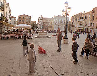 Children playing in the evening on the Campo Santo Stefano at Saint-Mark district