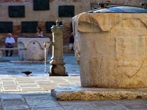 Wellhead on the Campo del Ghetto Nuovo Square in Venice in Italy