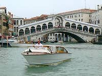 Motoscafo in front of the bridge of Rialto Venice Italy